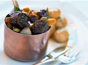 Venison ragout with minted new potatoes & vegetables