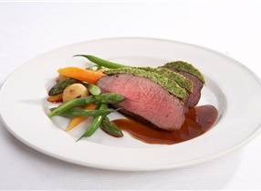 Roast of venison with herb crust and new vegetables